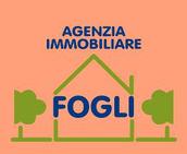 FOGLI AGENZIA IMMOBILIARE logo